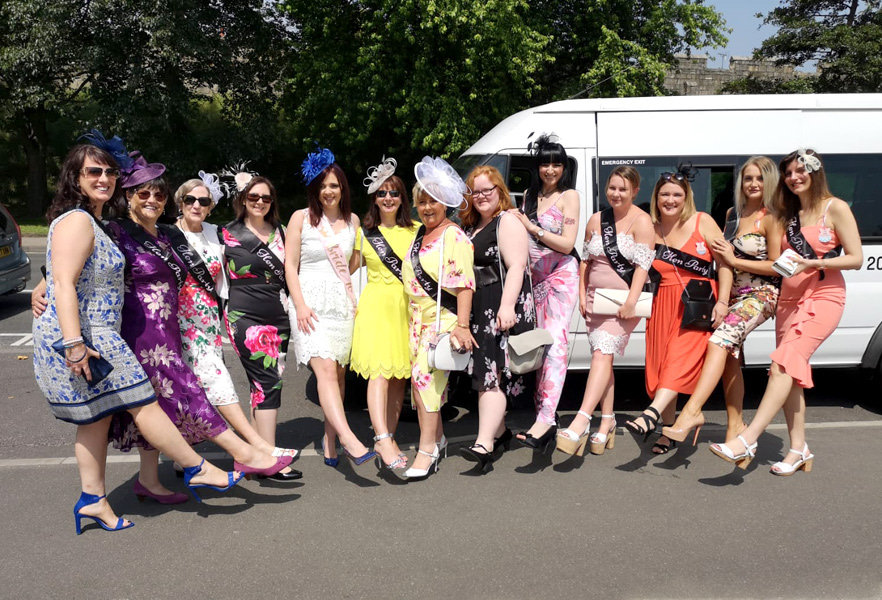 Ladies Day at the races – A group ready to enjoy their trip on a 16 seater with Lancaster Minibuses